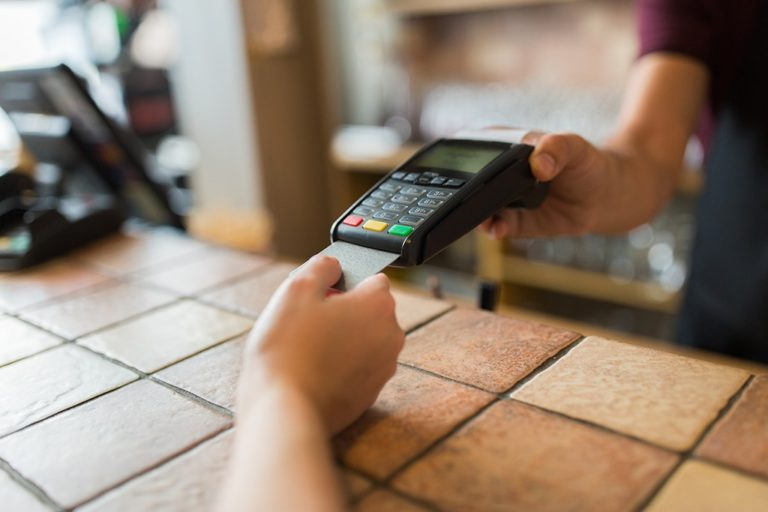 hands-with-payment-terminal-and-credit-card-2-768x512