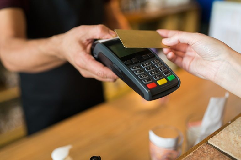 hands-with-payment-terminal-and-credit-card-3-768x512